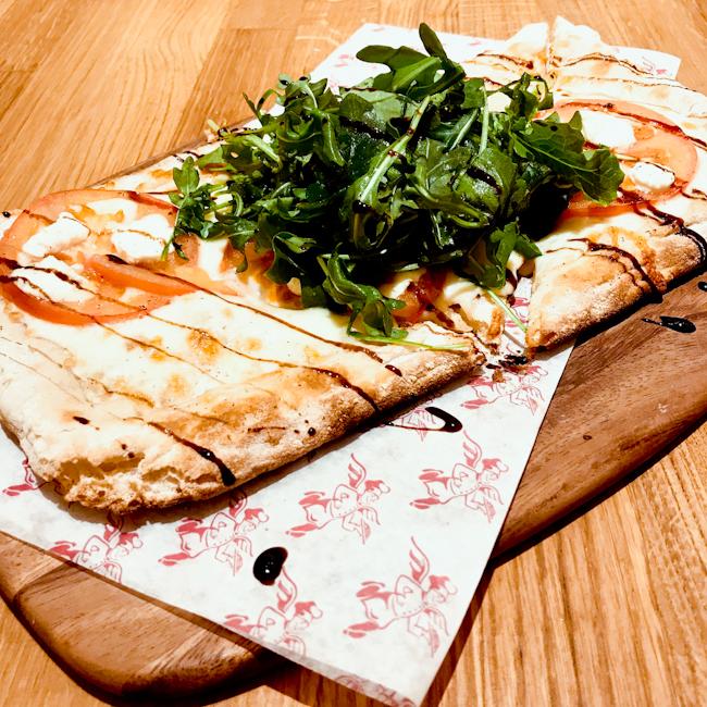 Mozzarella, Prosciutto di Parma, tomatoes and arugula pizza | ShesCookin.com