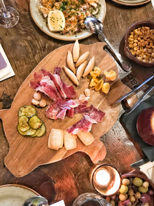 Jamon and cheese on pig shaped serving board and Spanish tapas at Vaca restaurant, Costa Mesa