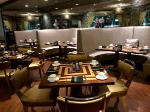Mood lighting and stylish booths at Silver Trumpet restaurant , Avenue of the Arts Hotel