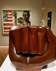 Wood sculpture of closed fist symbolizing Black Power