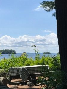 Picnic table overlooking Sebago Lake at Migis Lodge