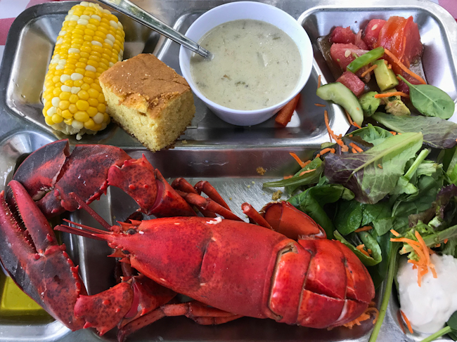 Grilled Maine Lobster with clam chowder and corn.