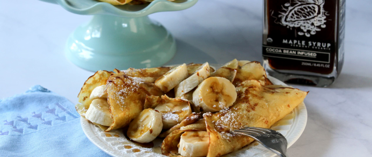 Crepes with bananas and chocolate maple syrup