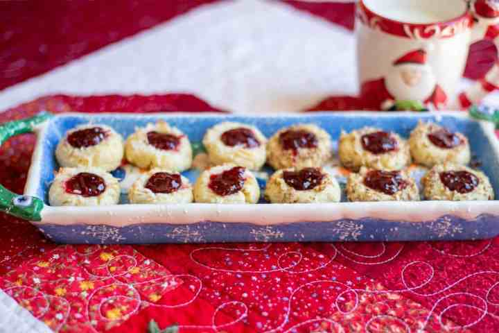 shortbread jam thumbprint cookie son blue plate with mug in background