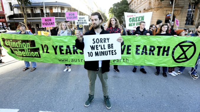 Seven climate change protesters have been arrested in Brisbane after blockades on Monday morning but the activist group still plans to disrupt traffic again within days.