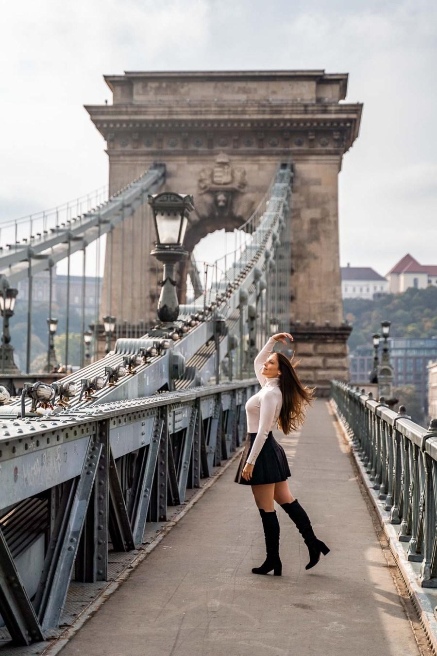 Girl standing on the Szechenyi Chain Bridge in Budapest