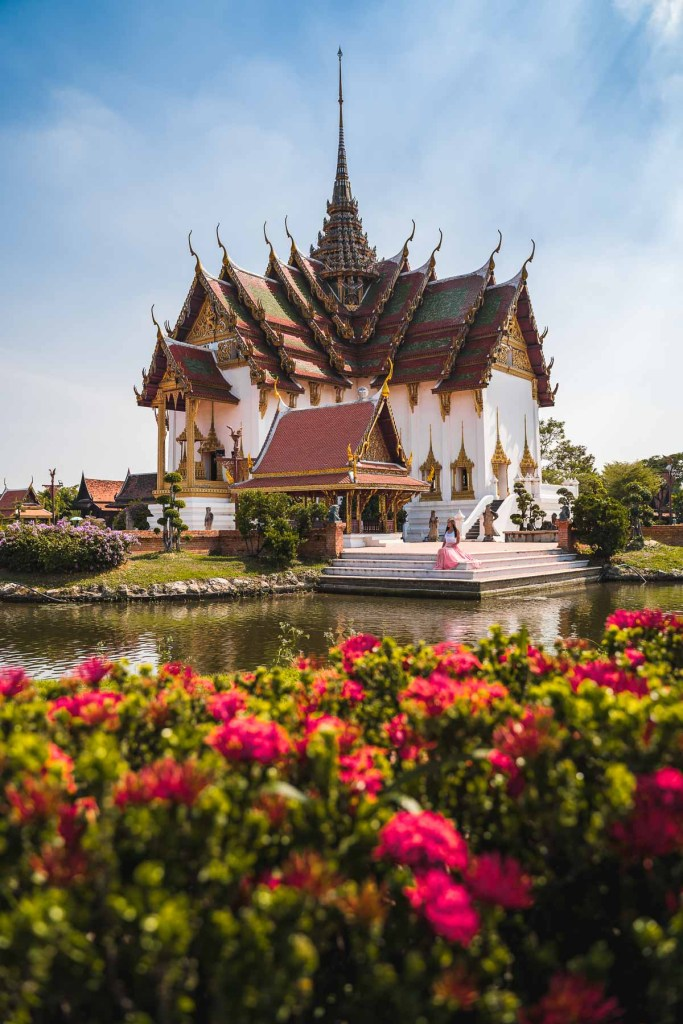 Beautiful temple with flowers in the foreground at the Ancient Siam Bangkok