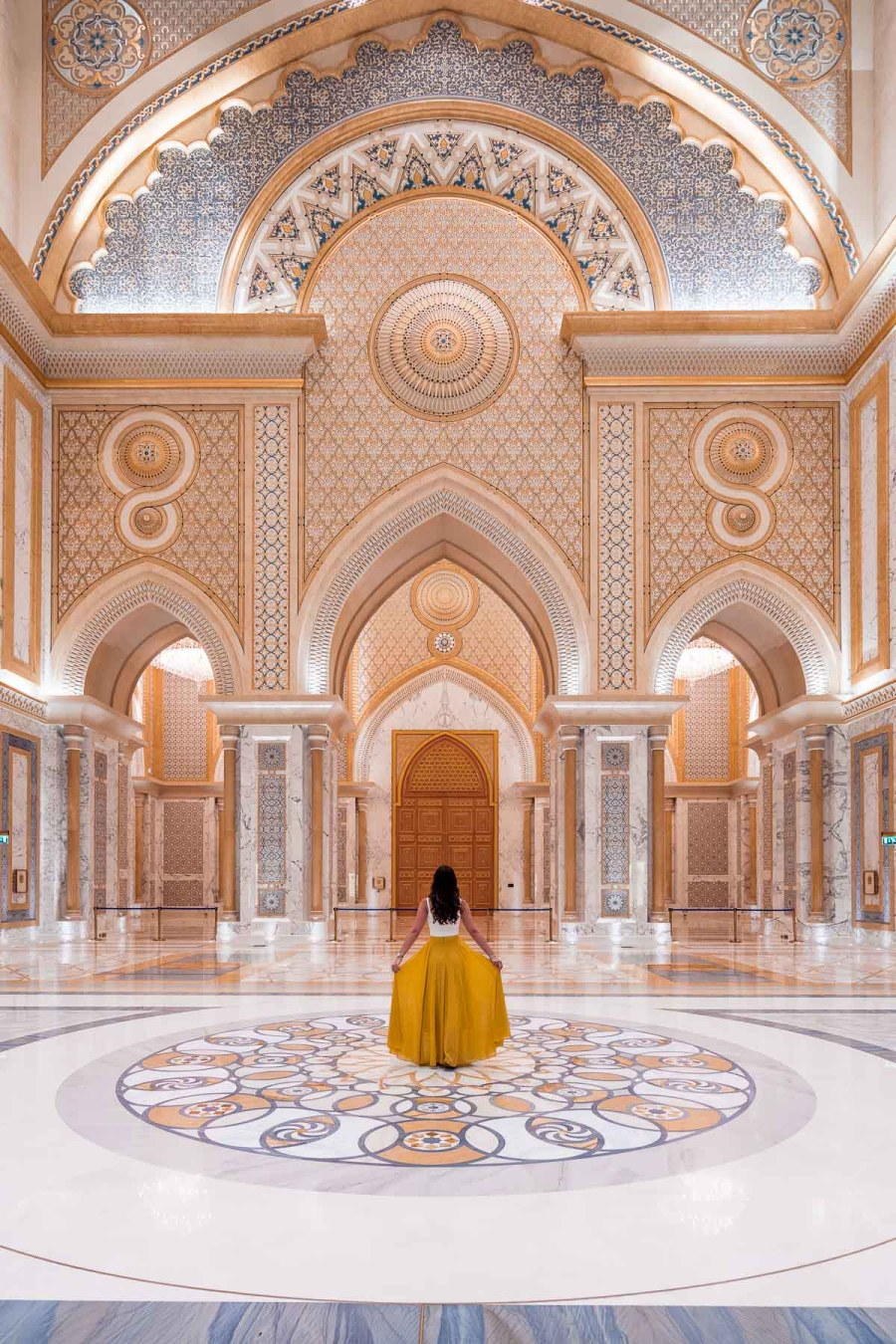 Girl in a yellow skirt standing in the middle of Qasr al Watan Palace, Abu Dhabi