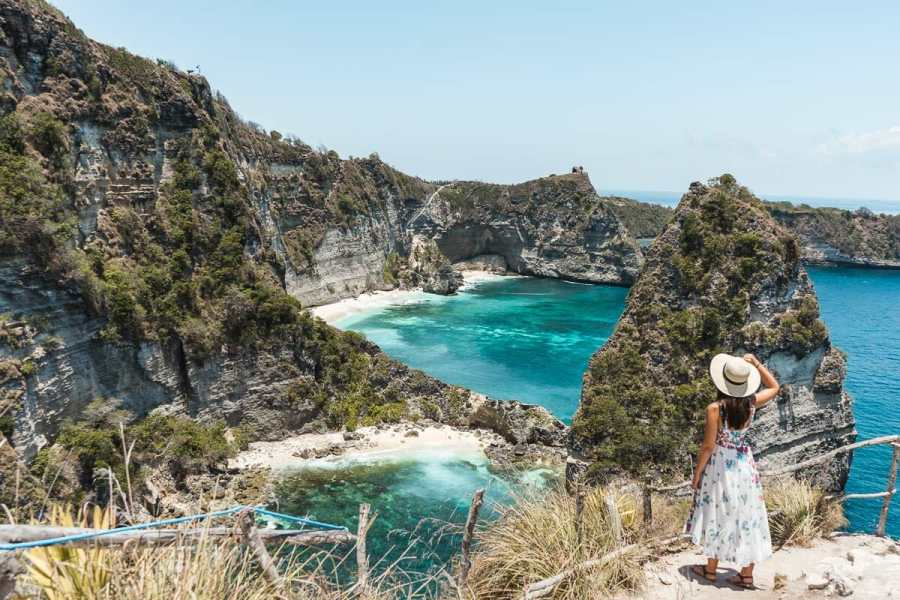 Girl in a white dress looking at the view at Thousand Islands Viewpoint on Nusa Penida