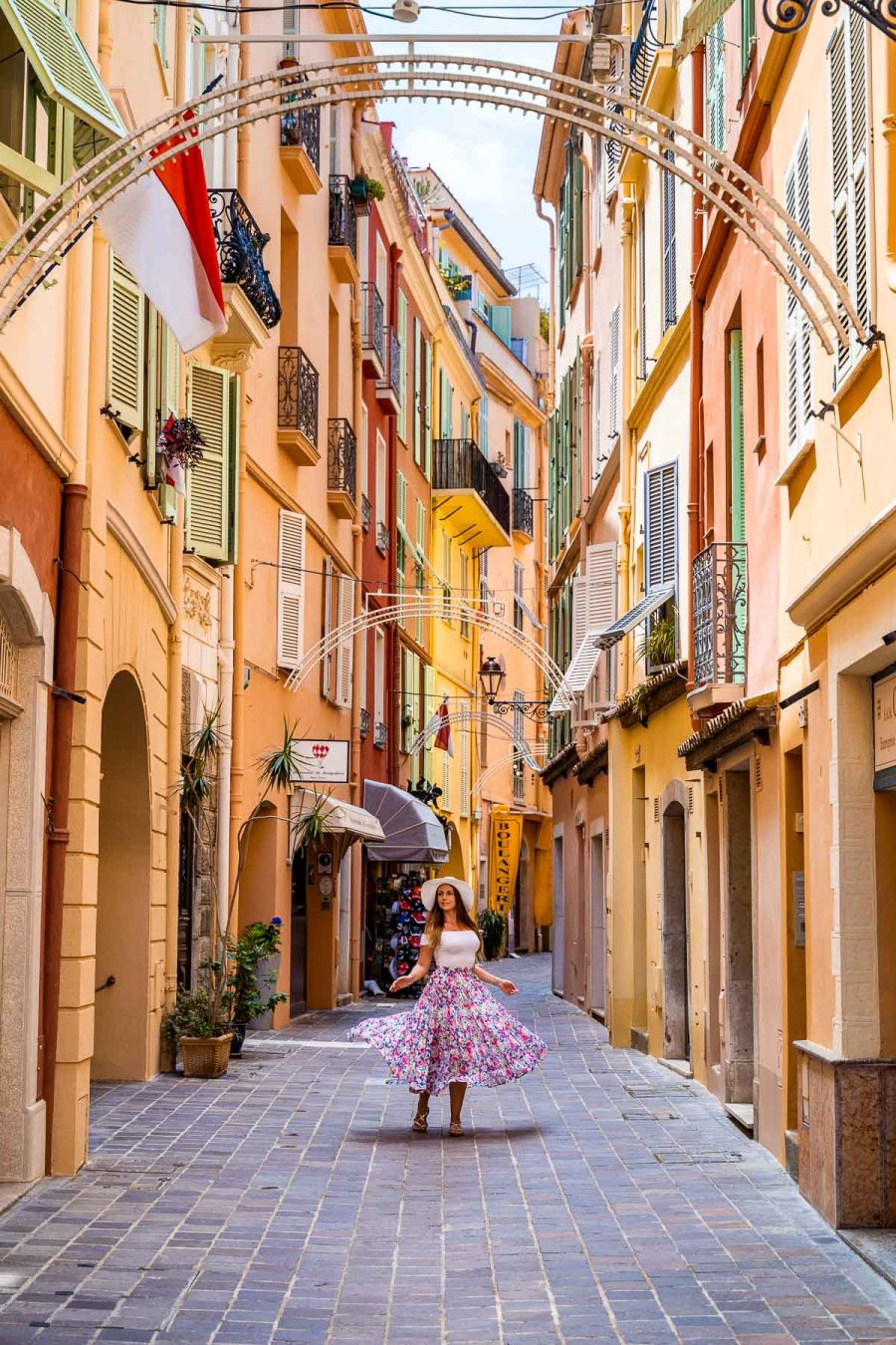Colorful houses in Monaco Old Town with girl in the middle