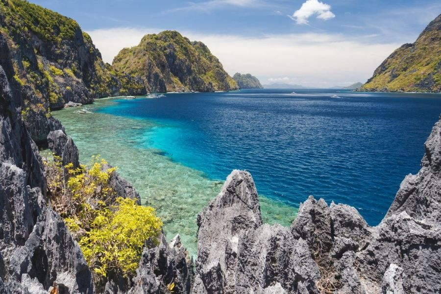 Cliffs and blue water on Matinloc island, Philippines