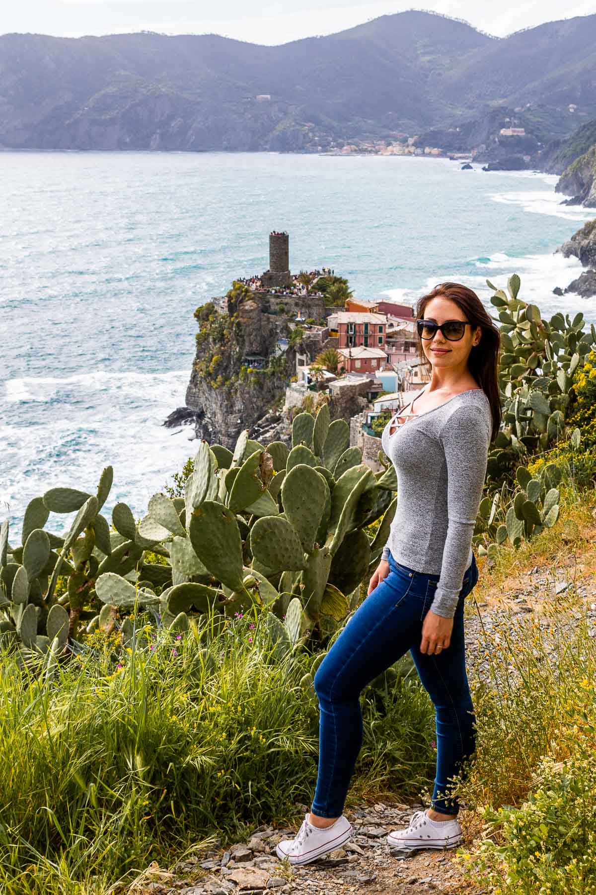 Panoramic view of Vernazza with girl in the middle in Cinque Terre, Italy