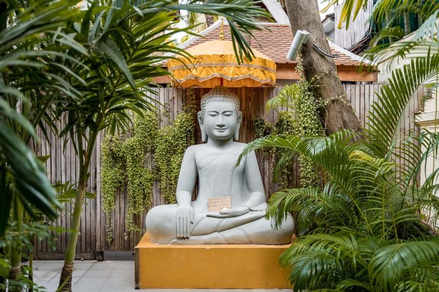 Buddha statue at the entrance of Entrance of Lobby at Pavilion Phnom Penh, Cambodia
