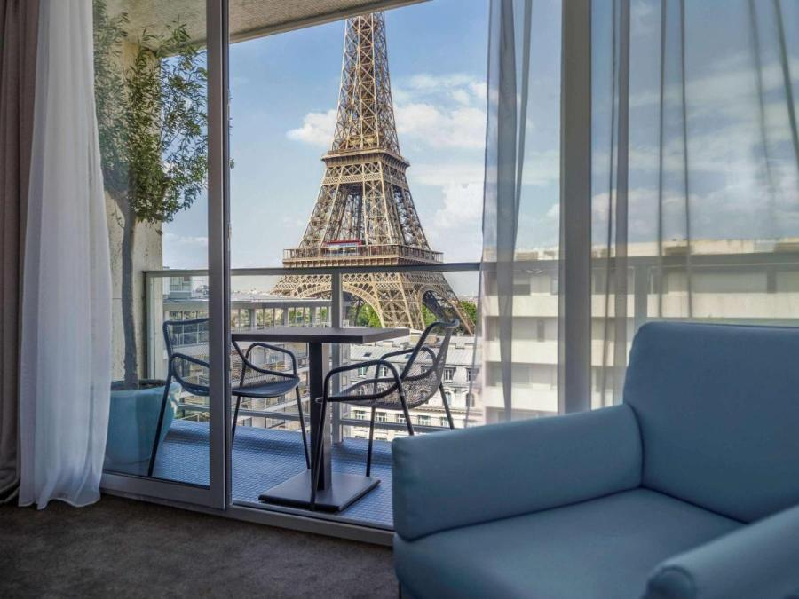 Room with balcony at Pullmann Paris Tour Eiffel hotel overlooking the Eiffel Tower