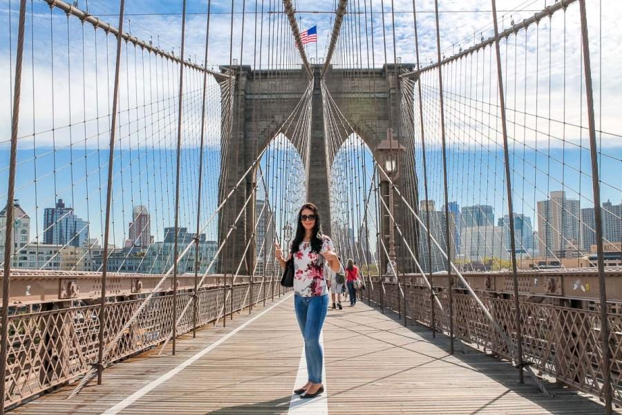 Girl standing on the Brooklyn Bridge in NYC