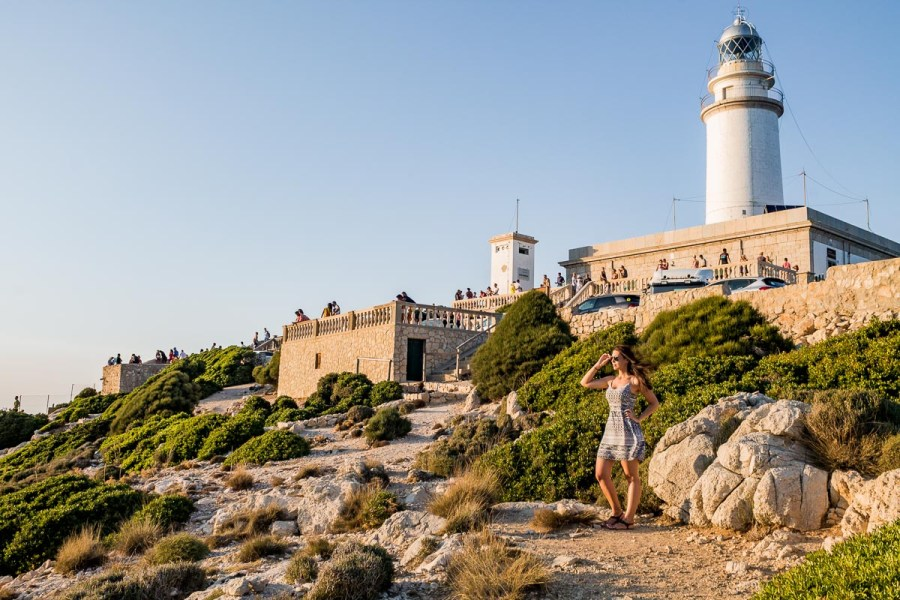 Girl standing in front of the lighthouse at Cap de Formentor in Mallorca