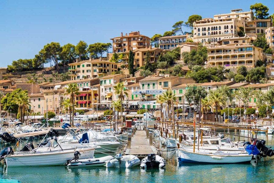 Yachts in the port in front of the colorful houses in Port de Soller, Mallorca