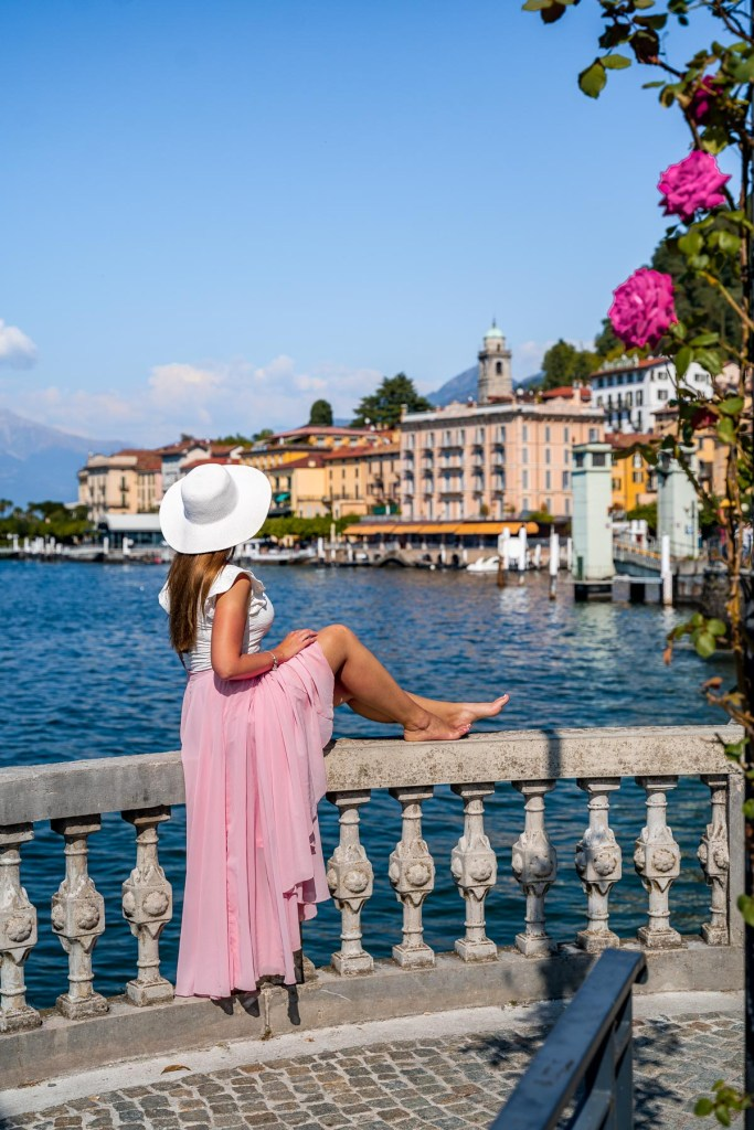 Girl in a pink skirt looking at the waterfront in Bellagio, Lake Como