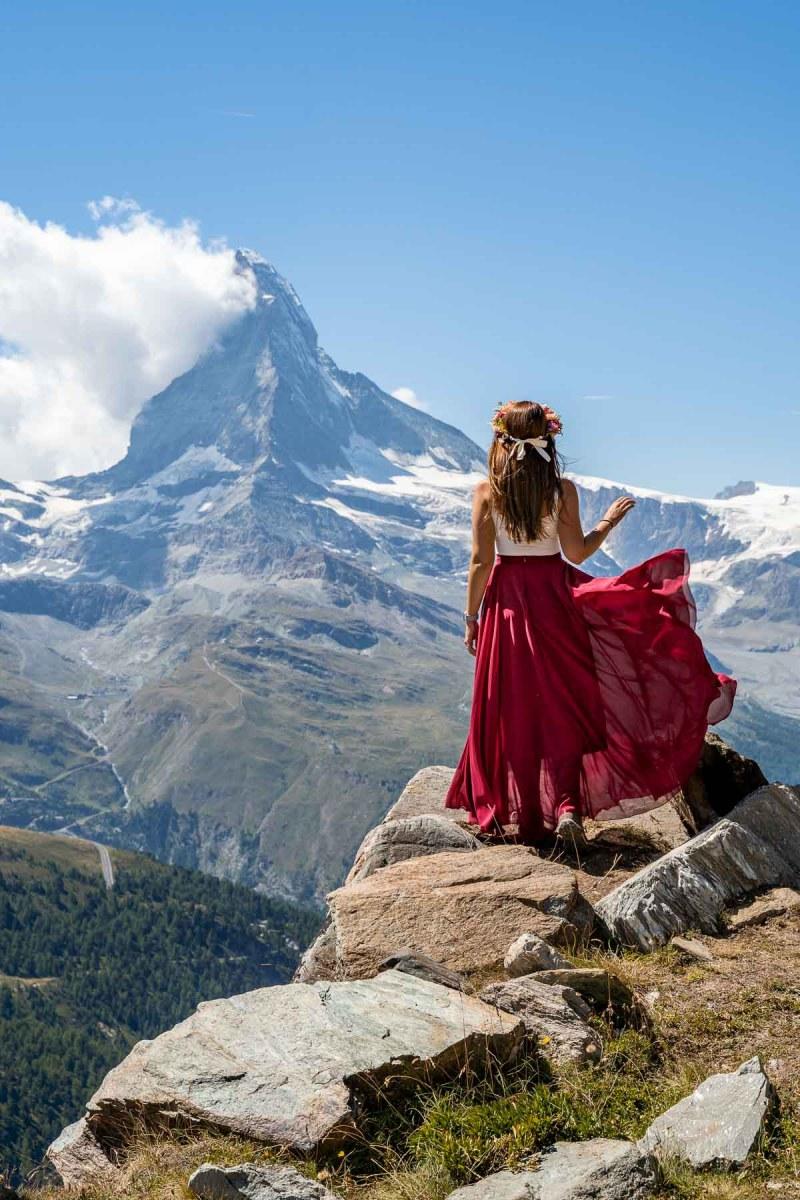 Girl in a red skirt in front of Matternhorn on the Zermatt 5 Lakes Hike