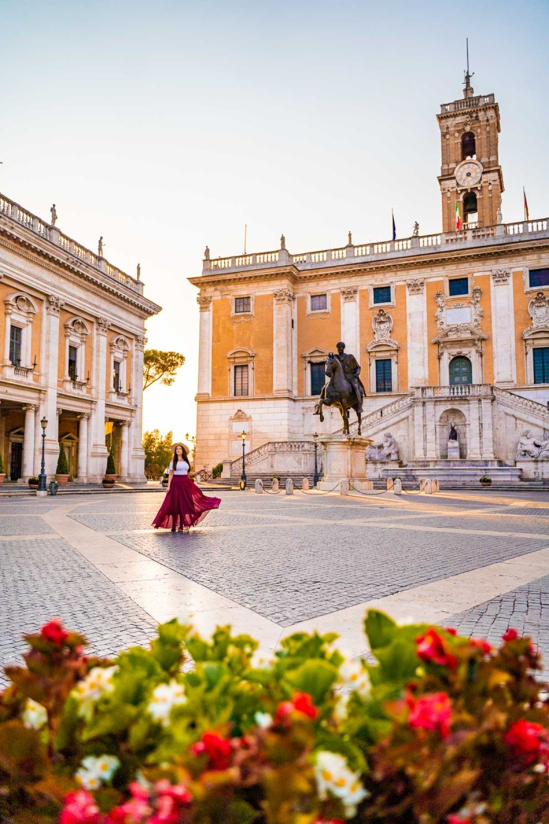 Girl in a red skirt in Piazza Campidoglio in Rome, Italy
