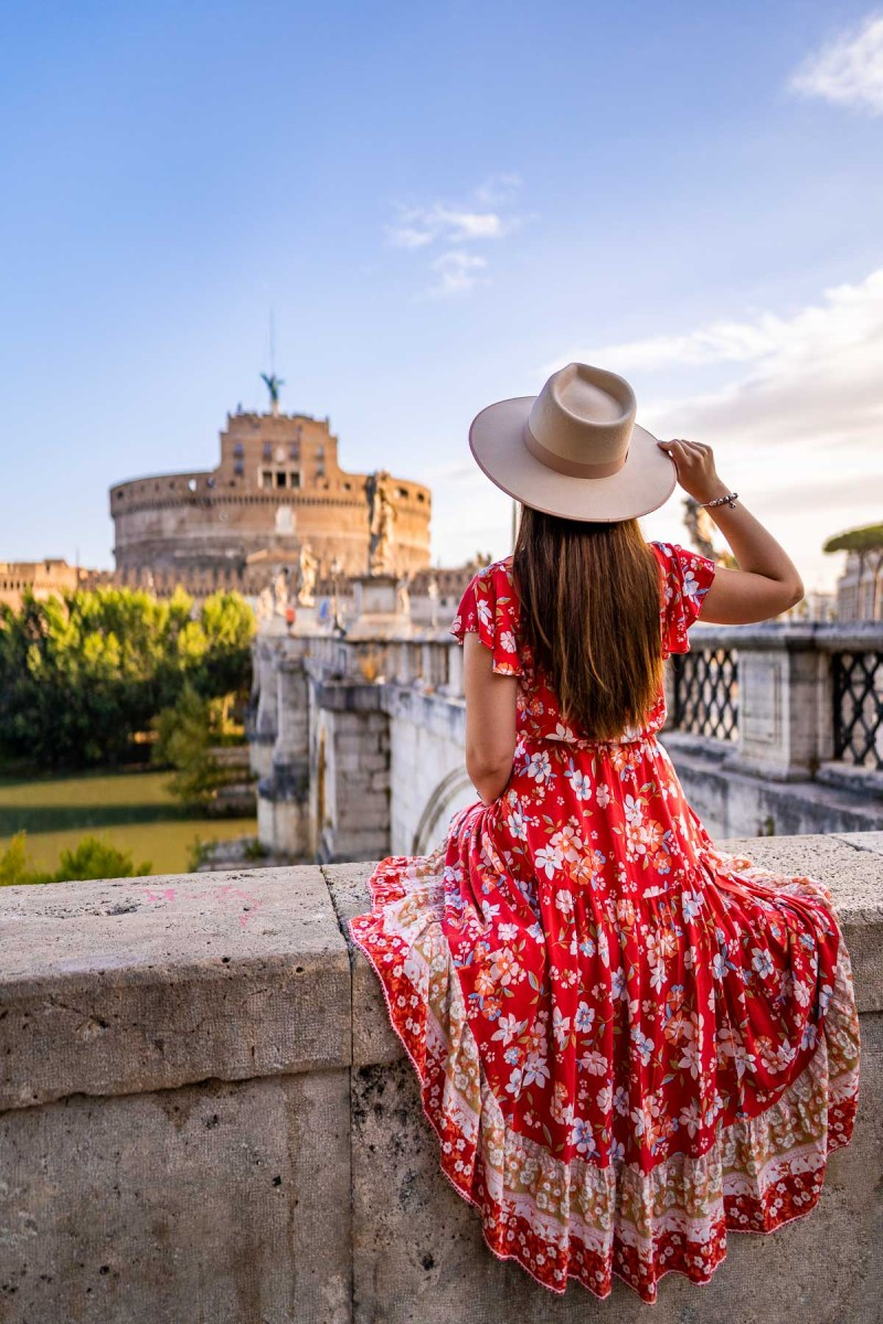 Girl in a red floral skirt in front of Castel Sant' Angelo, Rome