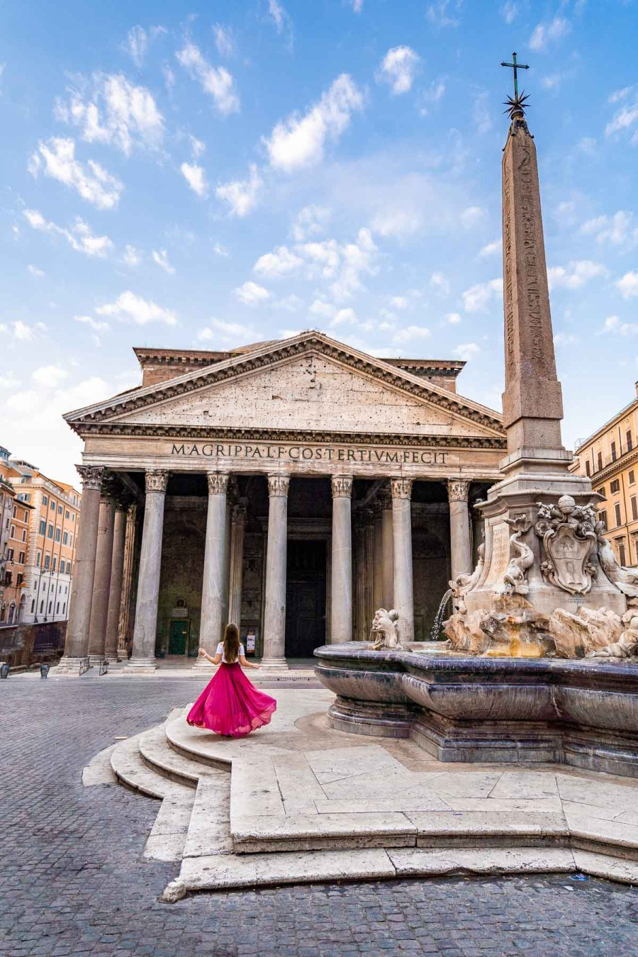 Girl in a pink skirt in front of the Pantheon in Rome, Italy