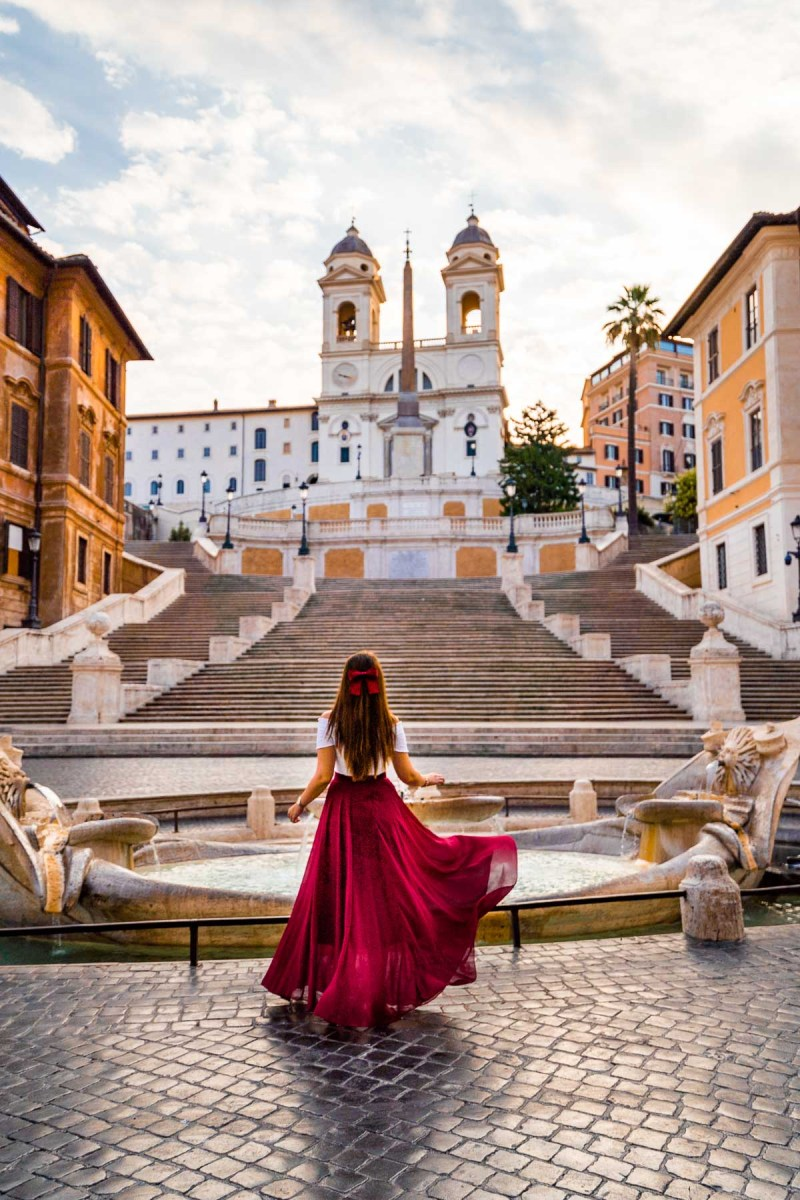 Girl in a red skirt in front of the Spanish Steps in Rome, Italy
