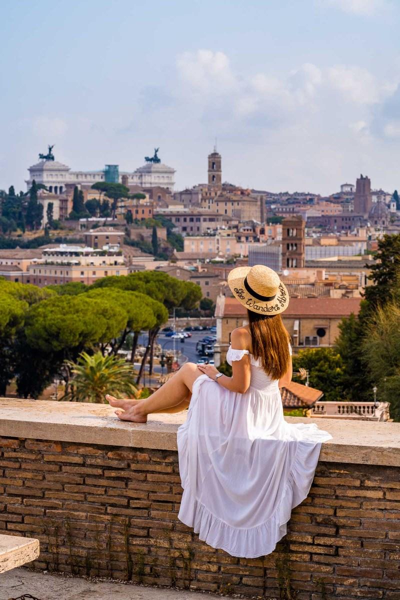 Girl in a white dress watching the view from Giardino degli Aranci, Rome