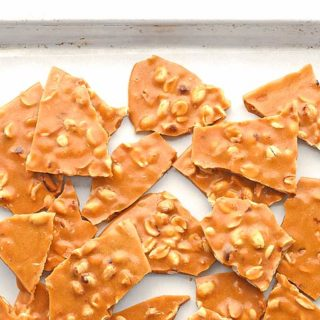 This Peanut Brittle Recipe is a favorite treat made with simple ingredients and cooks in about 15 minutes. It's the perfect edible gift during the holidays.