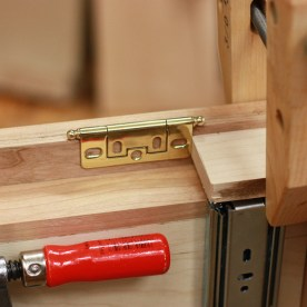 Case spacer to ensure the doors are one hinge width above the bottom of the case.