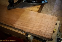Cleaning off the fuzz and flattening one side with my jack plane.