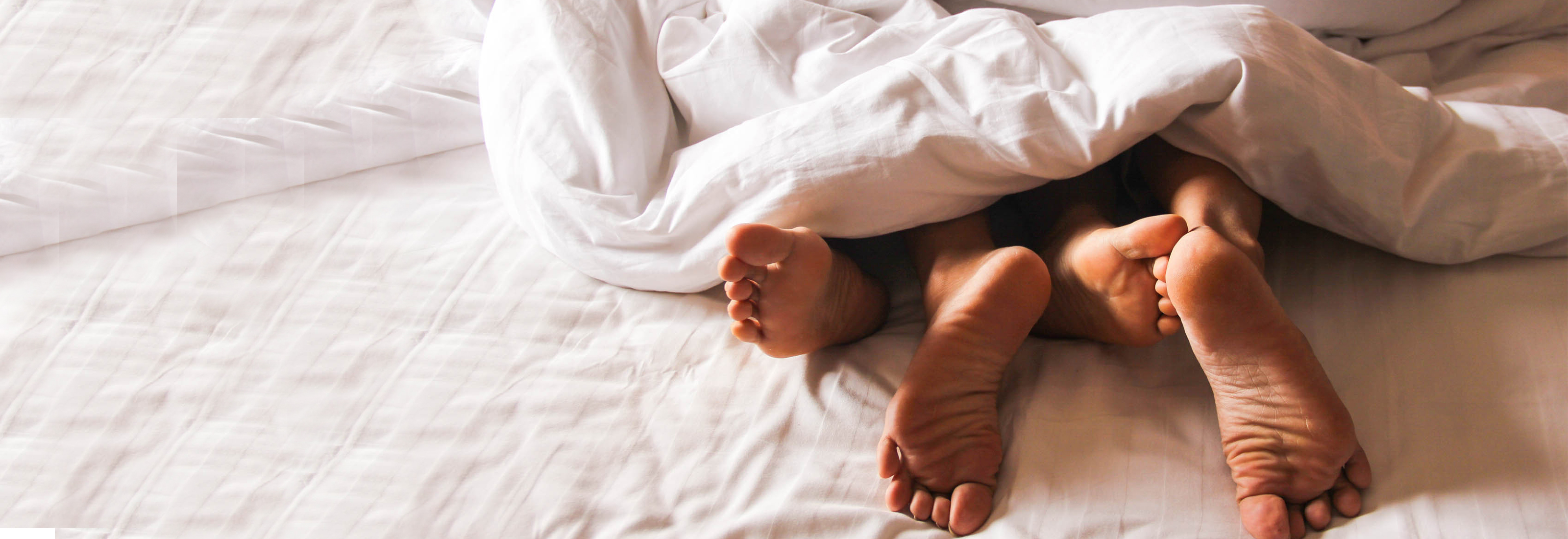 couples feet from blankets