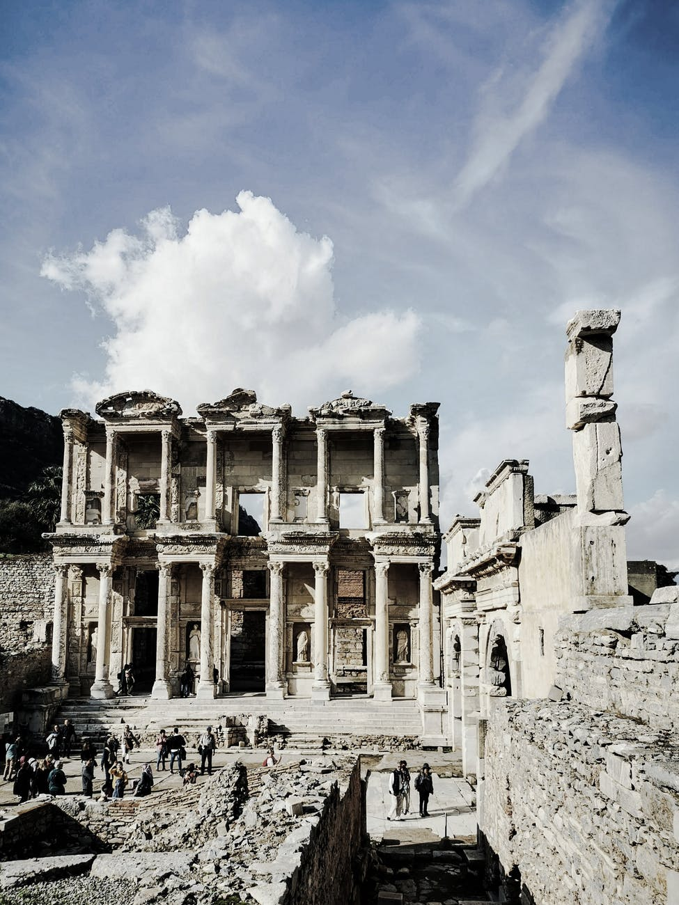 ancient library of celsus in ephesus under cloudy sky