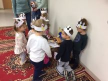 Presenting Birthday cards to Baby Jesus.