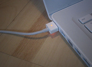 "Apple MagSafe plugged in a 13,3"" MacBook,..."