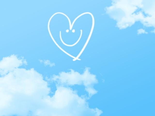 空に浮かぶハートの笑顔