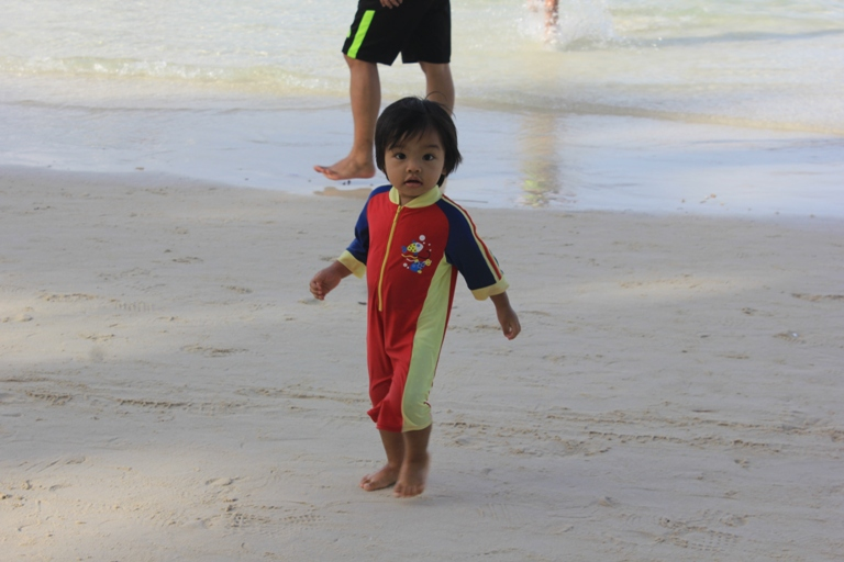 Again, the youngest in our clan enjoying the oh-so-smooth sand of the island!