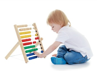 Little Boy Learning in Montessori Class