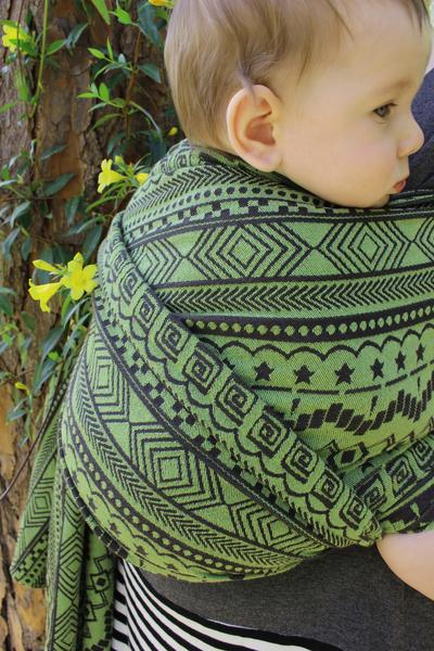 green/black geometric design woven wrap