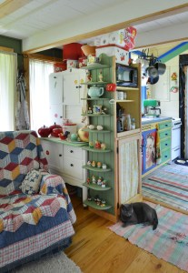 The hosier cupboard and dish/microwave/food pantry cupboard are at the end of the living room.