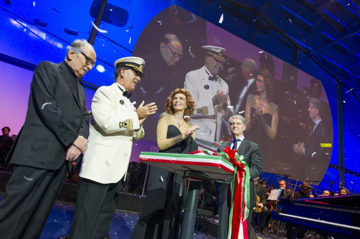Sophia Loren cuts the ribbon that sent the bottle crashing on to Preziosa's starboard bow