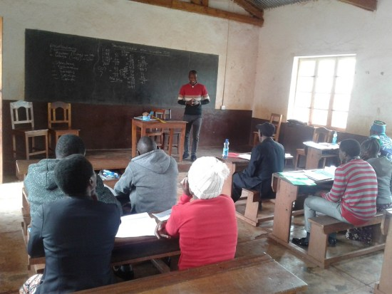 Ludewa District Education Officer Rep explaining on the school committee circular during the teachers workshop at Lufumbu 26 Feb 2020