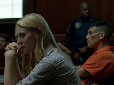 Karen and Frank sit in the courtroom for his trial in Daredevil season 2