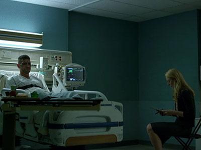 Karen and Frank speak in his hospital room in Daredevil season 2