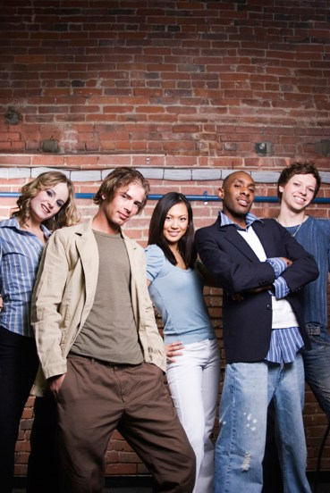 Five young people against a brick wall. They look pretty happy, knowing that they are the future of this planet. And a mixed bunch they are.