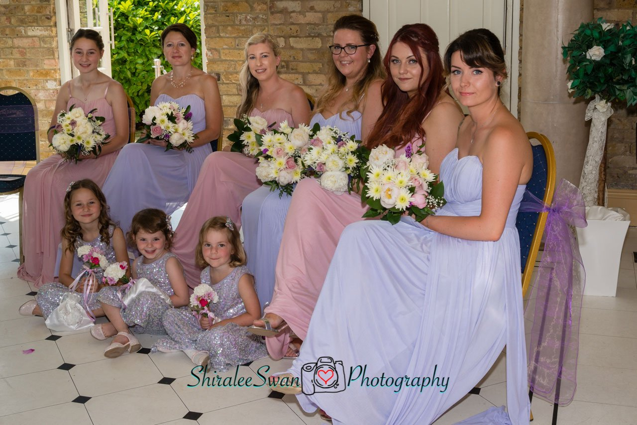 the bridesmaid are seated during the ceremony at Friern Manor
