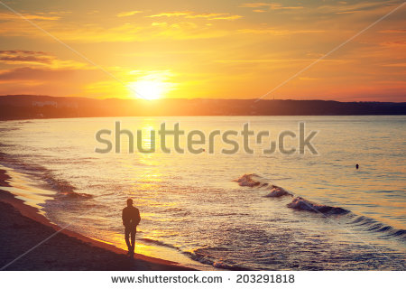 stock-photo-man-walking-alone-on-the-beach-at-sunset-calm-sea-with-rippling-waves-203291818[1]