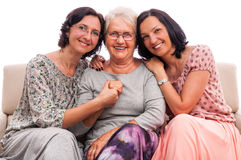 happy-family-three-women-senior-mother-embrace-embraced-tho-adult-daughters-isolated-white-background-31990539[1]
