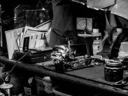 An old Olympus film camera under repair
