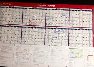 2014 calendar with trip planning papers below